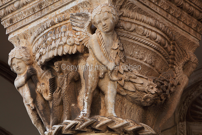 Carved capital with cherubs, animals and garlands, 15th century by Salvi di Michele in Renaissance style, on the porch on the facade of the Rector's Palace, built in the 15th century by Onofrio di Giordano della Cava, in Gothic and Renaissance style, Dubrovnik, Croatia. The city developed as an important port in the 15th and 16th centuries and has had a multicultural history, allied to the Romans, Ostrogoths, Byzantines, Ancona, Hungary and the Ottomans. In 1979 the city was listed as a UNESCO World Heritage Site. Picture by Manuel Cohen