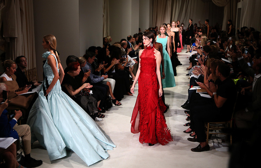 Models walks the runway during the Oscar de la Renta presentation at New York Fashion Week in New York, Tuesday, September 15, 2015. AFP PHOTO/TREVOR COLLENS