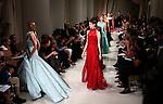 Models walks the runway during the Oscar de la Renta presentation at New York Fashion Week in New York, Tuesday, September 15, 2015. AFP PHOTO/TREVOR COLLENS