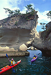 Sea kayaking, Japan, kayakers paddle through sandstone arches, Sendai, Fukushima, Honshu, Japan,