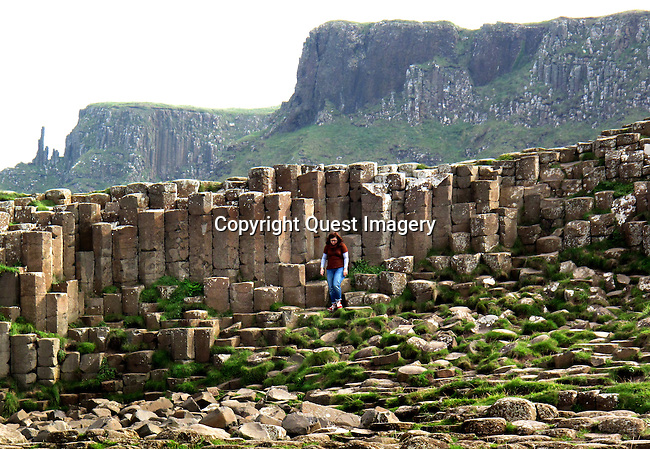 The Giant's Causeway is an area of about 40,000 interlocking basalt columns, the result of an ancient volcanic eruption. It is located in County Antrim on the northeast coast of Northern Ireland, about three miles northeast of the town of Bushmills. <br /> Photo by Mike Rynearson/Quest Imagery