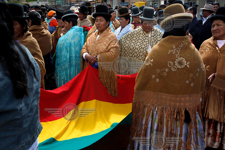 Women join the Bolivian Navy as they mourn the day they lost their ocean to Chile in the War of the Pacific. Bolivia lost what is now northern Chile in a war over nitrates leaving Bolivia without access to the ocean.