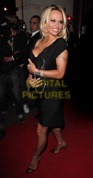 PAMELA ANDERSON.UK Premiere of 'The Commuter' at Aqua, Argyll Street, London, England, UK, October 25th 2010..full length black dress sleeveless pointy pointed shoes cleavage low cut bag tattoo .CAP/ROS.©Steve Ross/Capital Pictures
