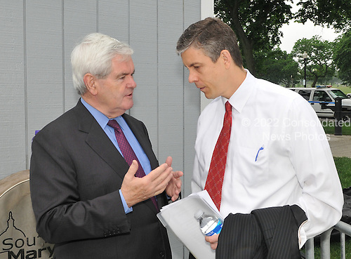 "Washington, DC - May 16, 2009 -- Former Speaker of the House Newt Gingrich (Republican of Georgia), left, and U.S. Secretary of Education Arne Duncan, right, share some private thoughts prior to the ""Close the Gap: Education Equality Day"" on the White House Ellipse in Washington, D.C. on Saturday, May 16, 2009..Credit: Ron Sachs / CNP.(RESTRICTION: NO New York or New Jersey Newspapers or newspapers within a 75 mile radius of New York City)"