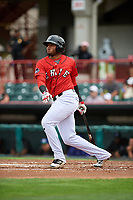 Erie SeaWolves third baseman Dawel Lugo (12) follows through on a swing during a game against the Hartford Yard Goats on August 6, 2017 at UPMC Park in Erie, Pennsylvania.  Erie defeated Hartford 9-5.  (Mike Janes/Four Seam Images)