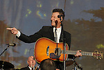 Lyle Lovett with guitar at Hardly Strictly Bluegrass