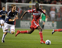 Chicago midfielder Patrick Nyarko (14) speeds away from Chivas midfielder Blair Gavin (18).  The Chicago Fire tied Chivas USA 1-1 at Toyota Park in Bridgeview, IL on May 1, 2010.
