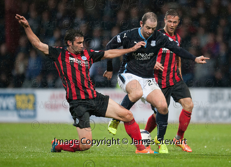 Dundee's Gary Harkins is challenged by St Johnstone's Simon Lappin.