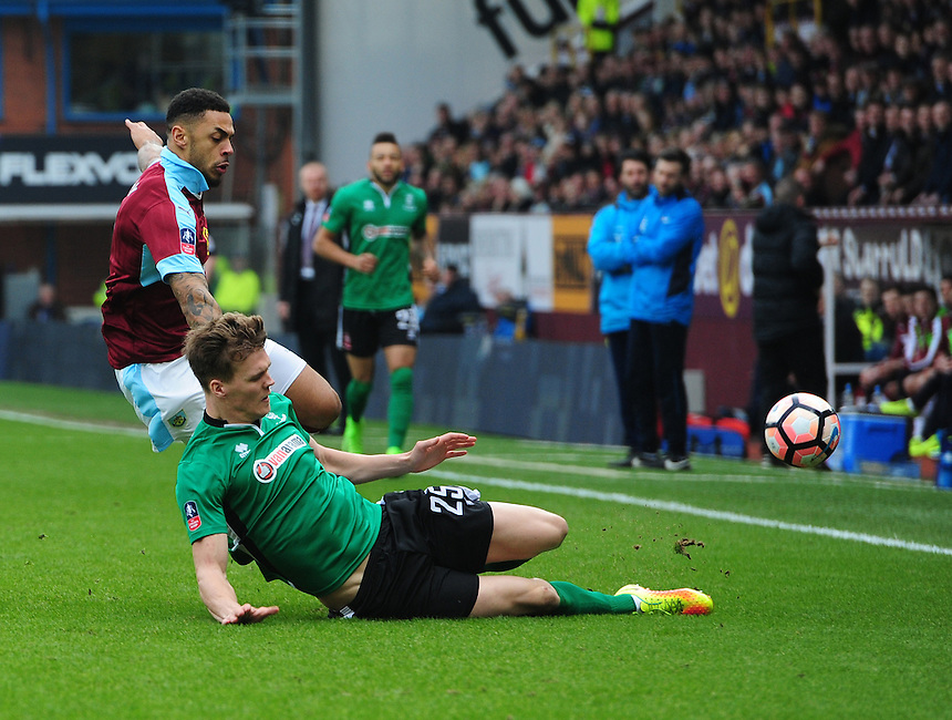 Burnley's Andre Gray is tackled by Lincoln City's Sean Raggett<br /> <br /> Photographer Chris Vaughan/CameraSport<br /> <br /> Emirates FA Cup Fifth Round - Burnley v Lincoln City - Saturday 18th February 2017 - Turf Moor - Burnley <br />  <br /> World Copyright &copy; 2017 CameraSport. All rights reserved. 43 Linden Ave. Countesthorpe. Leicester. England. LE8 5PG - Tel: +44 (0) 116 277 4147 - admin@camerasport.com - www.camerasport.com