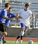 SIOUX FALLS, SD - SEPTEMBER 29:  Alex Einsel #20 from O'Gorman pushes the ball past Mark Schlichte #9 and Jacob Henderson #7 from St. Thomas More in the first half of their match Saturday evening at O'Gorman. (Photo by Dave Eggen/Inertia)