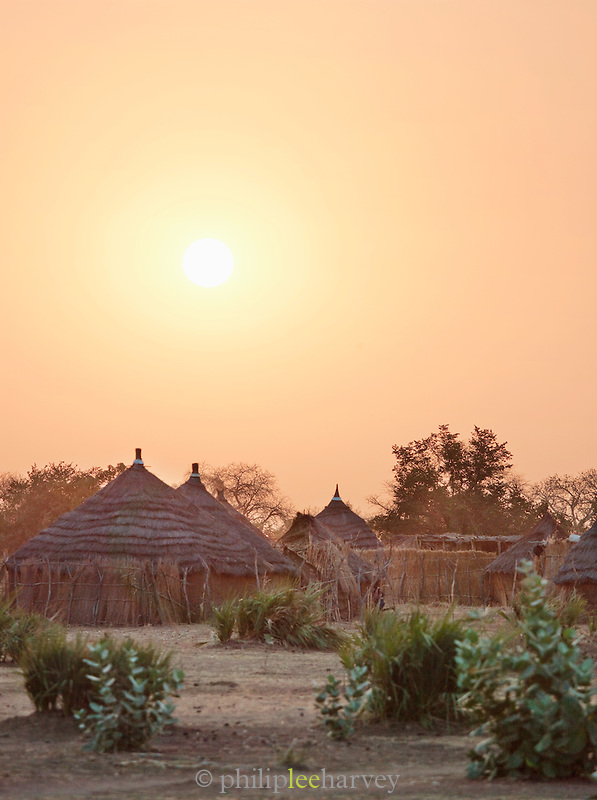 Thatched huts at sunset in the village of Nyaro, of the Nuba tribe in Kordofan Region, Sudan