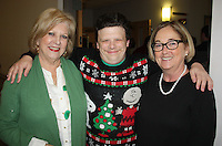 NWA Democrat-Gazette/CARIN SCHOPPMEYER Ryan Haney (center), joins Terrye Brosh (left) and Karen McDonald, Life Styles board members, at the organization's annual Christmas celebration Dec. 12.