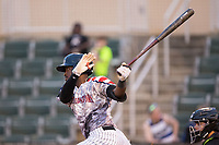 Micker Adolfo (27) of the Kannapolis Intimidators follows through on his swing against the Hickory Crawdads in game two of a double-header at Kannapolis Intimidators Stadium on May 19, 2017 in Kannapolis, North Carolina.  The Intimidators defeated the Crawdads 9-1.  (Brian Westerholt/Four Seam Images)