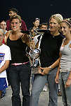 14 July 2004: Jen Grubb (second from left) and Siri Mullinix (second from right) hold the Founders Cup Trophy while posing for photos with some fans. The Washington Freedom defeated the Nottingham Forest Ladies 8-0 at RFK Stadium in Washington, DC during an exhibition matched played to honor the Freedom's 2002 WUSA championship..
