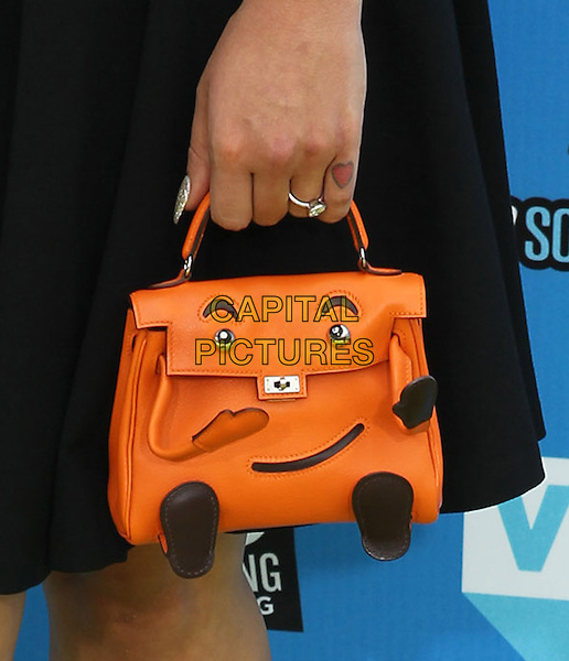 Kelly Osbourne's bag<br /> DoSomething.org And VH1's 2013 Do Something Awards Held At Avalon, Hollywood, California, USA.<br /> July 31st, 2013<br /> hand detail face orange black brown tattoo heart diamond ring<br /> CAP/ADM/KB<br /> &copy;Kevan Brooks/AdMedia/Capital Pictures