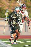 Redondo Beach, CA 05/11/10 - Tajee Mobley (MC # 25) and Josh Carroll (PV # 18) in action during the 2010 Los Angeles Boys Lacrosse championship game, Mira Costa defeated Palos Verdes 12-10 at Redondo Union High School.