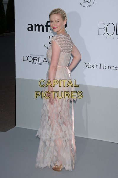 KIRSTEN DUNST.amfAR's Cinema Against AIDS Gala during the 64th Annual Cannes Film Festival at Hotel Du Cap, Antibes, France, May 19th, 2011..full length white lace sheer dress tiered side looking over shoulder see thru through pale pink long maxi .CAP/PL.©Phil Loftus/Capital Pictures