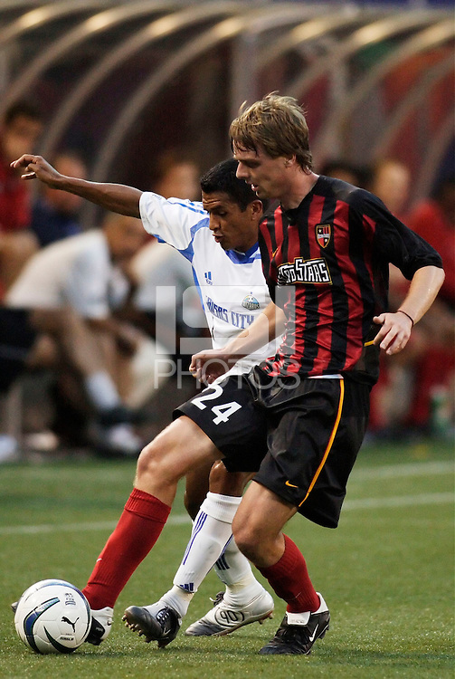 The Wizard's Diego Gutierrez marks the MetroStars' Eddie Gaven. The Kansas City Wizards were defeated by  the NY/NJ MetroStars to a 1 to 0 at Giant's Stadium, East Rutherford, NJ, on May 30, 2004.