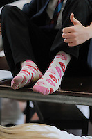 Non-regulation socks worn by the lead boy at after school rehearsal for the school play, State secondary Roman Catholic school.  This school has just moved into a brand new, purpose built building.