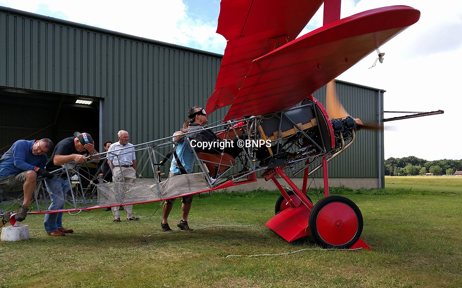 BNPS.co.uk (01202 558833)<br /> Pic: PhilYeomans/BNPS<br /> <br /> Peter fires up the engine...as volunteers hang on to the tail.<br /> <br /> Dreaded Red Baron to fly again...WW1 Ace's feared 'Fokker Dreidecker' to finally fly over Britain.<br /> <br /> A German GP based in Norfolk has spent 8 years building a Fokker triplane in his garage as a tribute to infamous WW1 Ace Manfred von Ricthofen, who terrorised the skies over the Western front during the first war.<br /> <br /> Dr Peter Brueggemann, 52, will fulfil his childhood dream and emulate the notorious German fighter pilot when the Dreidecker Dr.1 fighter finally achieves lift-off this summer.<br /> <br /> Dr Brueggemann has even acquired the title Baron from the independent territory of Sealand so he can take to the skies as Baron Peter von Brueggemann in homage to his idol.<br /> <br /> The GP at the Holt Medical Practice in Norfolk hopes to be airborne in a few months once tests on the engine are completed at Felthorpe airfield near Norwich where he has devoted thousands of hours to the project.<br /> <br /> The father-of-two, who has lived in England with wife Sue for 20 years, has been taking flying lessons since his project began.