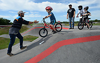 James Stevenson of Rogers (left), who has been riding since 1974, helps young riders enter a section of the track to work on techniques Saturday, Aug. 1, 2020, during a workshop led by Stevenson at the pump track at Runway Bike Park at The Jones Center in Springdale. Stevenson and several local riders spent the morning teaching young riders how to navigate the pump track and how to position themselves on their bicycles. Visit nwaonline.com/200803Daily/ for today's photo gallery.<br /> (NWA Democrat-Gazette/Andy Shupe)