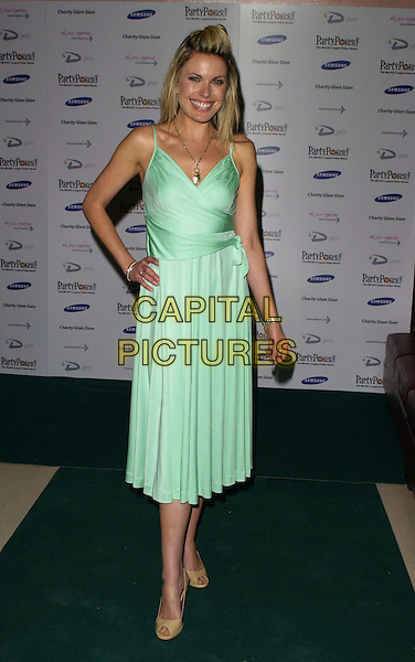 JODIE McMULLEN.At Charity Glam Slam Poker Tournament, .Titanic, Brewer Street, London, England, .April 22nd 2006..full length green dress hair quiff.Ref: CAN.www.capitalpictures.com.sales@capitalpictures.com.©Can Nguyen/Capital Pictures