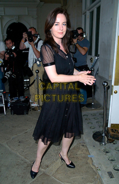 AMANDA DREW.The Marks and Spencer Autumn / Winter previews 2007 at The Piazza Covent Garden, London, England..May 24th, 2007.m&s M & S full length black sheer dress .CAP/CAN.©Can Nguyen/Capital Pictures