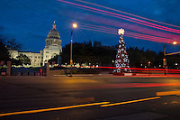 Texas State Capitol Building with illuminated Christmas Tree at dusk in downtown Austin, Texas.