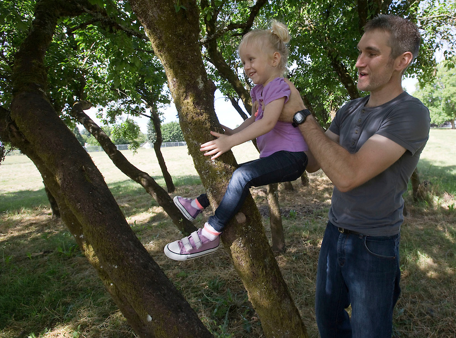 Kyle Potter plays with his daughter Emmy 3, at the Sorenson Neighborhood Park in Vancouver Thursday June 30, 2016. The park is one of two neighborhood parks will be built this summer to provide additional recreation within easy walking distance of nearby residents. (Photo by Natalie Behring/ The Columbian)