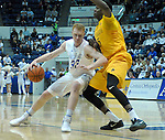 February 4, 2017:  Air Force center, Frank Toohey #33, drives for the basket again Cowboy forward, Alan Herndon #5, during the NCAA basketball game between the Wyoming Cowboys and the Air Force Academy Falcons, Clune Arena, U.S. Air Force Academy, Colorado Springs, Colorado.  Wyoming defeats Air Force 83-74.