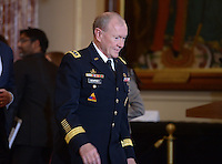 November 20, 2013  (Washington, DC)  Gen. Martin Dempsey, Chairman of the Joint Chiefs of Staff, enters the Ben Franklin Room at the State Department preceding a joint press availability between U.S and Australian officials. (Photo by Don Baxter/Media Images International)