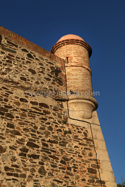 Detail of watchtower and walls, Chateau Royal, Collioure, France. Much of the castle was built in the 13th and 14th centuries by the Dukes of Roussillon and the Knights Templar. In the 16th century Collioure was under Spanish control and Philip II modernised and reinforced the castle. It was taken by the French in 1659 after which the bastions were built by Vauban (1633-1707). Picture by Manuel Cohen.