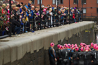 10 AUG 2014 - LIVERPOOL, GBR - Spectators watch from the quayside as competitors walk onto the pontoon for the start of their wave at the Tri Liverpool triathlon which incorporated the 2014 British Age Group Triathlon Championships in Kings Dock in Liverpool, Great Britain (PHOTO COPYRIGHT © 2014 NIGEL FARROW, ALL RIGHTS RESERVED)