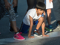 NWA Democrat-Gazette/ANTHONY REYES • @NWATONYR<br /> Krish Sharda, 7, gets ready for the start of a race Monday, Sept. 7, 2015 at the 12th Annual Run for a Child's Hunger race at the Promenade in Rogers. Krish and his family were participating in the one mile fun run. The race has teamed up with Care Community Center to help fight hunger in the region. The event featured multiple activities including a 10K race, 5K race, fun run, inflatable playground for children and a free breakfast.