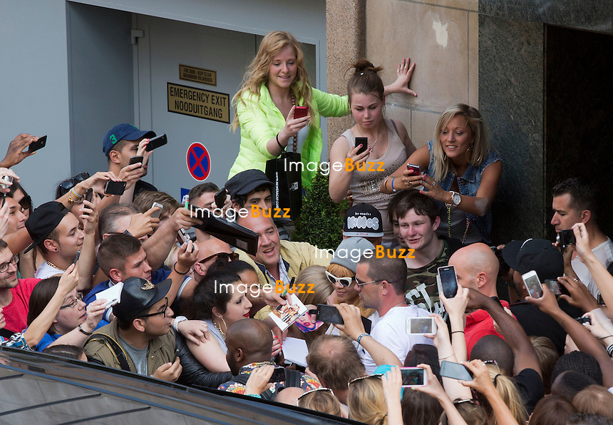 RIHANNA SWARiMED BY FANS AT ANTWERP HOTEL IN BELGIUM - Rihanna heads out of her hotel and gets swarmed by a mob of fans while trying to get into her limousine on Thursday afternoon (June 6, 2013), in Antwerp, Belgium.