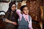 18/04/15. Goktapa, Iraq. Rahima combr her daughter's hair every morning before school.