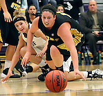 SIOUX FALLS, SD - DECEMBER 6:  Sam Knecht #50 from the University of Sioux Falls and Millie Niggeling #40 from Wayne State watch the ball roll away in the first half of their game Friday night at the Stewart Center. (Photo by Dave Eggen/Inertia)