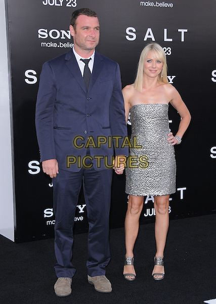 LIEV SCHREIBER & NAOMI WATTS.Premiere of SALT held at The Grauman's Chinese Theatre in Hollywood, California, USA. .July 19th, 2010         .full length strapless silver dress black suit brown shoes holding hands couple open toe sandals grey hand on hip.CAP/RKE/DVS.©DVS/RockinExposures/Capital Pictures.