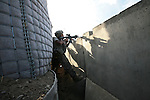 Sgt. Henry Vega-Gonzalez, 32, of Rio Grande, Puerto Rico, a soldier with Company B, 1st Battalion, 12th Infantry Regiment returns fire at Taliban fighters who've attacked a U.S. outpost near the village of Ashoque, in Zhari district, Kandahar province, Afghanistan. Dec. 3, 2009 DREW BROWN/STARS AND STRIPES