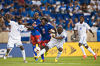 Haiti forward Leonel Saint Preux (18) battles for the ball with Honduras defender Johnny Palacios (4) and defender Osman Chavez (2). Honduras defeated Haiti 2-0 during a CONCACAF Gold Cup group B match at Red Bull Arena in Harrison, NJ, on July 8, 2013.