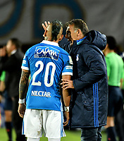 BOGOTA - COLOMBIA - 20 – 05 - 2017: Miguel Angel Russo (Der.), técnico, de Millonarios, da instrucciones a Juan Guillermo Dominguez (Izq.) jugador de Millonarios, durante partido de la fecha 19 entre Millonarios y Patriotas F.C., por la Liga Aguila I-2017, jugado en el estadio Nemesio Camacho El Campin de la ciudad de Bogota. / Miguel Angel Russo (R), coach of Millonarios, gives instructions to Juan Guillermo Dominguez (L) player of Millonarios, during a match of the date 19th between Millonarios and Patriotas F.C., for the Liga Aguila I-2017 played at the Nemesio Camacho El Campin Stadium in Bogota city, Photo: VizzorImage / Luis Ramirez / Staff.