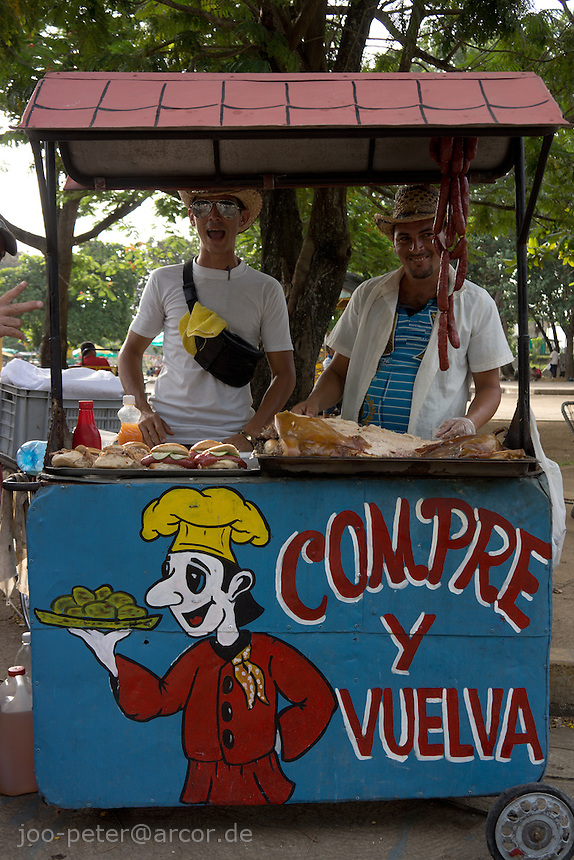 food seller on fair, entertainment park, July carneval in Santa Clara, city in central Cuba, famous for Che Guevara and his turning point victory for Cuba revolution in this town.