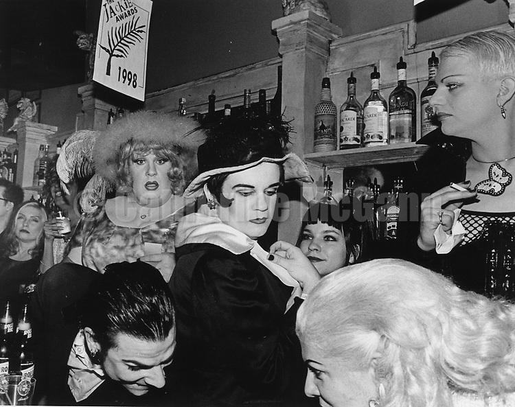 1998:  A typical scene at the bar at Jackie 60 nightclub in New York City.  Debbie Harry on far right.
