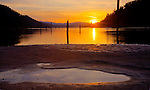 Idaho, North, Kootenai County, Coeur d'Alene. Low water levels on Lake Coeur d'Alene, reveal pools and sandbars in Wolf Lodge bay at sunset.