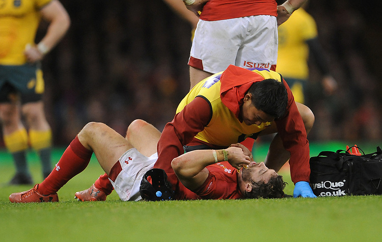 Wales' Leigh Halfpenny receives treatment after his collision with Australia's Samu Kerevi (Not in frame)<br /> <br /> Photographer Ian Cook/CameraSport<br /> <br /> Under Armour Series Autumn Internationals - Wales v Australia - Saturday 10th November 2018 - Principality Stadium - Cardiff<br /> <br /> World Copyright © 2018 CameraSport. All rights reserved. 43 Linden Ave. Countesthorpe. Leicester. England. LE8 5PG - Tel: +44 (0) 116 277 4147 - admin@camerasport.com - www.camerasport.com