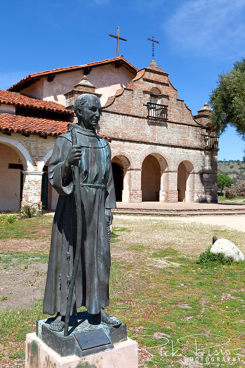 "Statue of Father Junipero Serra stands at Mission San Antonio de Padua. Mission San Antonio de Padua sits within the ""Valley of the Oaks"" in Monterey County near the town of Jolon. The mission was founded on July 14, 1771 by Father Junipero Serra and was the third mission in Alta California. Mission San Antonio de Padua is located on eighty pristine acres on what was once the Milpitas Unit of the Hearst Ranch and is today surrounded by the Army's Fort Hunter Ligget Military Reservation."
