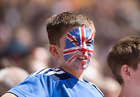 A Young boy with Union Jack face paint watches the action during the Sainsbury's Anniversary Games, Athletics event at the Olympic Park, London, England on 25 July 2015. Photo by Andy Rowland.