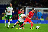 Shaun Williams of Republic of Ireland vies for possession with Aaron Ramsey of Wales during the UEFA Nations League B match between Wales and Ireland at Cardiff City Stadium in Cardiff, Wales, UK.September 6, 2018