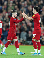 5th January 2020; Anfield, Liverpool, Merseyside, England; English FA Cup Football, Liverpool versus Everton; Harvey Elliott of Liverpool high fives goalscorer Curtis Jones of Liverpool as he is substituted late in the second half - Strictly Editorial Use Only. No use with unauthorized audio, video, data, fixture lists, club/league logos or 'live' services. Online in-match use limited to 120 images, no video emulation. No use in betting, games or single club/league/player publications