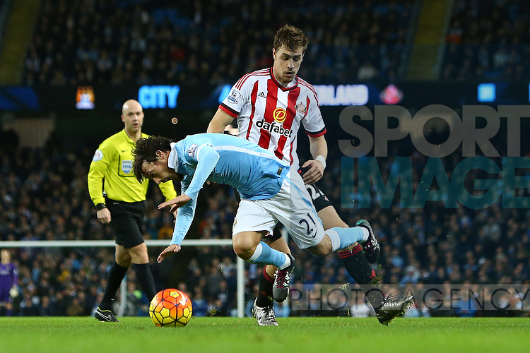 Sebastian Coates of Sunderland fouls David Silva of Manchester City to give away a penalty kick - Manchester City vs Sunderland - Barclays Premier League - Etihad Stadium - Manchester - 26/12/2015 Pic Philip Oldham/SportImage
